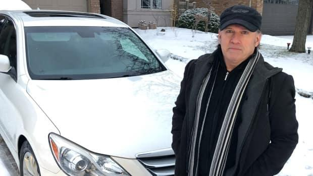 David Rooney spent seven months battling Bell and its third party contractor after an employee used a tool used for digging holes in the ground to try to wash mud off Rooney's car, peeling the paint off.  (Robert Krbavac/CBC - image credit)
