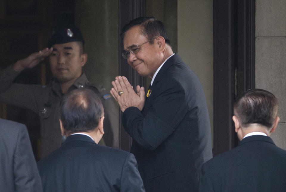 CORRECTS TYPO - Thailand's Prime Minister Prayuth Chan-ocha, center, arrives at government house in Bangkok, Thailand, Thursday, June 6, 2019. Thailand's Parliament elected 2014 coup leader Prayuth Chan-ocha as prime minister in a vote Wednesday that helps ensure the military's sustained dominance of politics since the country became a constitutional monarchy nearly nine decades ago. (AP Photo/Sakchai Lalit)