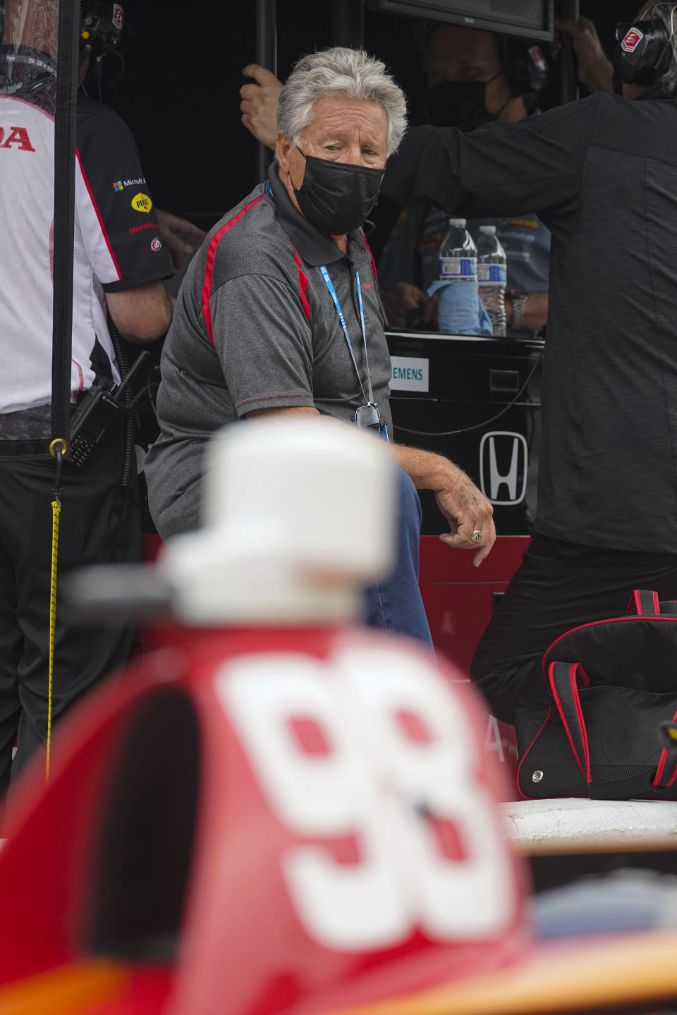 Mario Andretti watches as his grandson Marco Andretti practices for the Indianapolis 500 auto race at Indianapolis Motor Speedway in Indianapolis, Tuesday, May 18, 2021. (AP Photo/Michael Conroy)