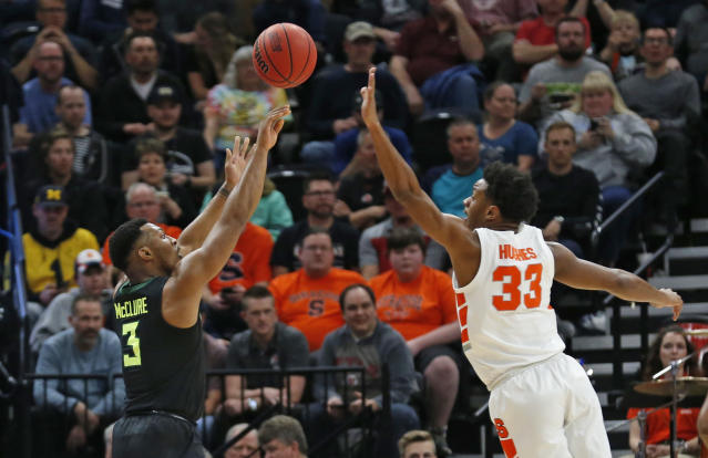 Baylor guard King McClure (3) shoots as Syracuse forward Elijah Hughes (33) defends during the first half of a first-round game in the NCAA mens college basketball tournament Thursday, March 21, 2019, in Salt Lake City. (AP Photo/Rick Bowmer)