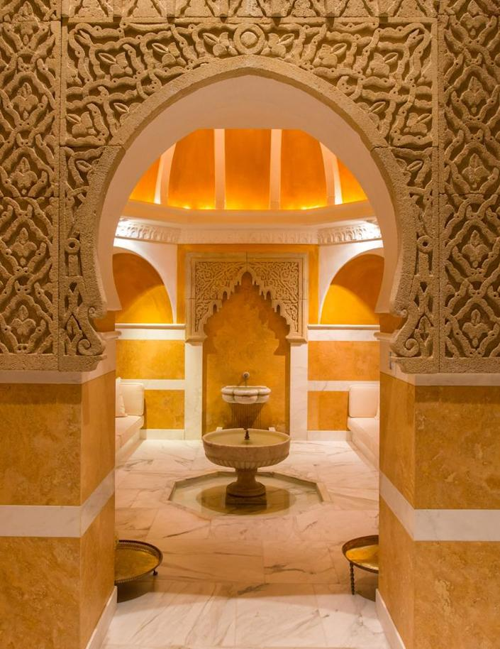 <p>Three hundred Moroccan nomadic tribesmen were employed to create the intricately carved sandstone ceiling, archways and capitals in the hammam spa. (Photo by Steve Brown/Sepia Productions)</p>
