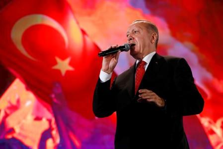 Turkish President Erdogan addresses his supporters during a ceremony marking the third anniversary of the attempted coup at Ataturk Airport in Istanbul