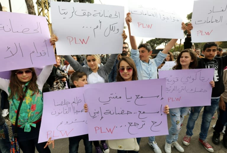 Lebanese protesters rally in front of the Supreme Shiite Council in Beirut to demand clerics increase the age at which the custody of children in divorce cases can be awarded to the mother