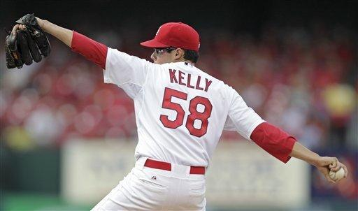 St. Louis Cardinals starting pitcher Joe Kelly (58) pitches in the second inning of a baseball game against the Colorado Rockies, Tuesday, July 3, 2012 in St. Louis.(AP Photo/Tom Gannam)