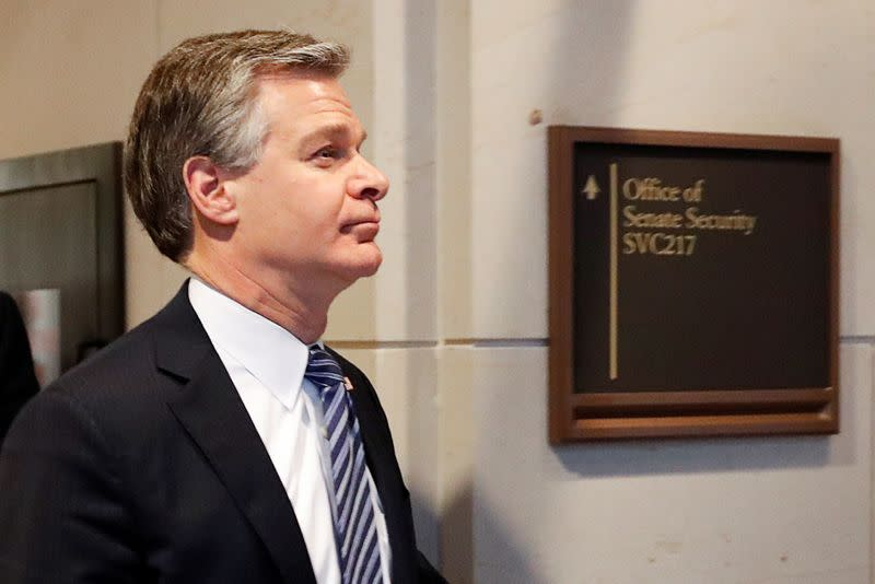 FILE PHOTO: FBI Director Wray departs following national security briefing for members of Congress about Russian election interference on Capitol Hill in Washington