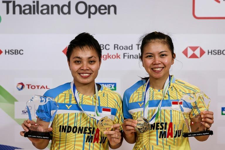 Indonesia's Apriyani Rahayu (left) and Greysia Polii after winning the women's doubles crown at the Thailand Open badminton tournament in Bangkok