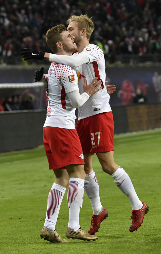 Leipzig's Timo Werner, left, celebrates together with Leipzig's Konrad Laimer, right, after scoring a goal during the German first division Bundesliga soccer match between RB Leipzig and Bayern Munich in Leipzig, Germany, Sunday, March 18, 2018. (AP Photo/Jens Meyer)