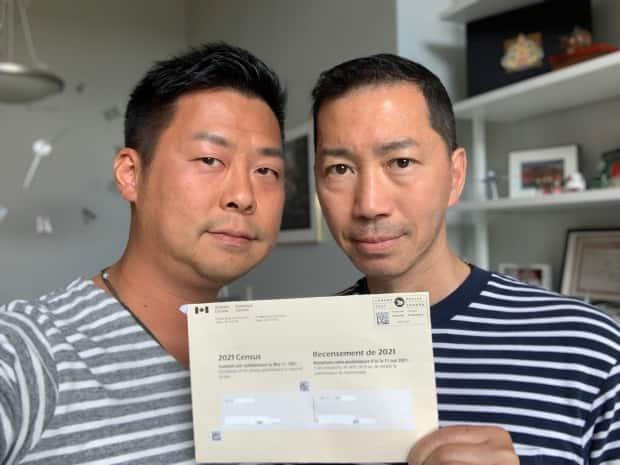 Henry Lam, left, and his husband, Guy Ho, want fellow Canadian Hong Kongers to note their identity on the 2021 long-form census. (Submitted by Henry Lam - image credit)
