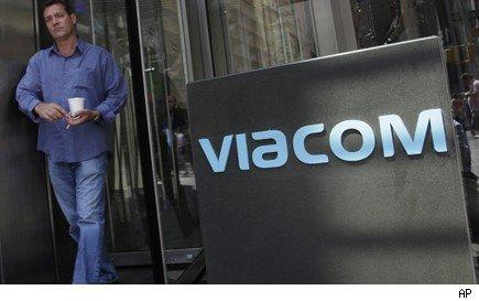 sign at viacom headquarters next to man carrying a coffee cup