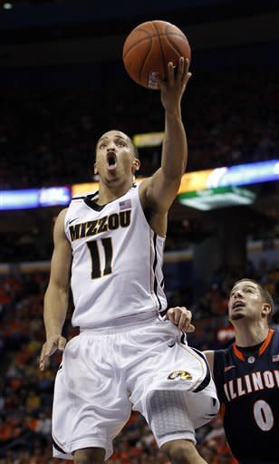 Missouri's Michael Dixon, left, heads to the basket as Illinois' Sam Maniscalco defends during the second half of an NCAA college basketball game, Thursday, Dec. 22, 2011, in St. Louis. Missouri won 78-74. (AP Photo/Jeff Roberson)
