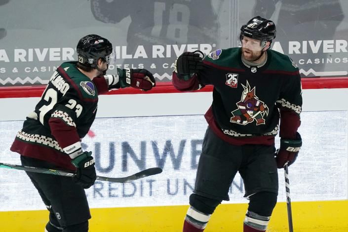 Arizona Coyotes right wing Phil Kessel, right, celebrates his goal against the San Jose Sharks with teammate Oliver Ekman-Larsson (23) during the first period of an NHL hockey game Saturday, Jan. 16, 2021, in Glendale, Ariz. (AP Photo/Ross D. Franklin)