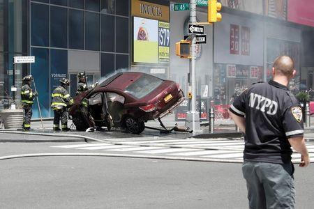 A vehicle that struck pedestrians in Times Square and later crashed is seen on the sidewalk in New York City, U.S., May 18, 2017. REUTERS/Mike Segar