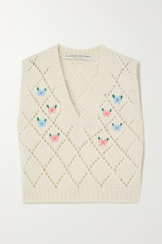 "<p>Alessandra Rich Embroidered Pointelle-Knit Alpaca Blend Vest, $555,<a href=""https://rstyle.me/+S-yGX4yKJRYVAONQl75luw"" rel=""nofollow noopener"" target=""_blank"" data-ylk=""slk:available here."" class=""link rapid-noclick-resp""> available here.</a> </p>"