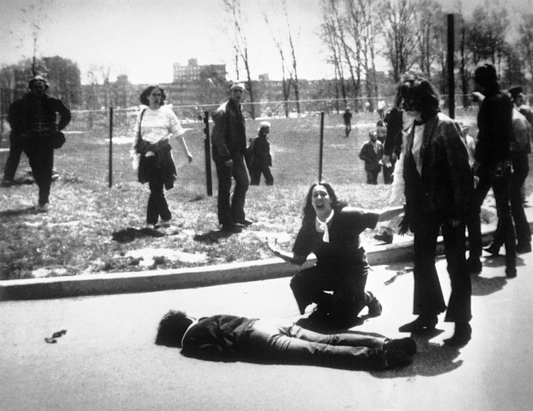 FILE - In this May 4, 1970 file photo, Mary Ann Vecchio screams as she kneels by the body of a student lying face down on the campus of Kent State University in Kent, Ohio . National Guardsmen had fired into a crowd of demonstrators, killing four. (AP Photo/John Filo, File)