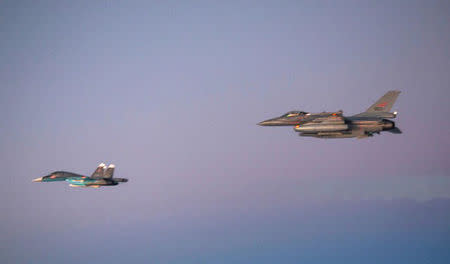 The Russian Air Force (RuAF) new Su-34 Fullback strike aircraft (front) is seen escorted by a Norwegian Air Force jet in this October 31, 2014 photo released by the Norwegian Air Force on November 13, 2014.  REUTERS/Norwegian Air Force/Handout via Reuters