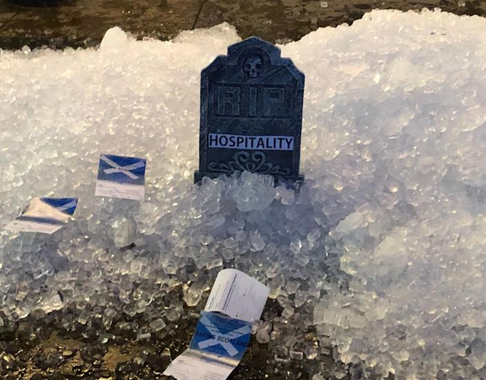 Left over ice dumped on the street in Glasgow in a protest by hospitality workers, as temporary restrictions announced by First Minister Nicola Sturgeon to help curb the spread of coronavirus have come into effect from 6pm on Friday.