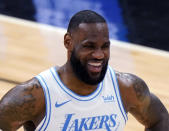 FILE - In this Jan. 23, 2021, file photo, Los Angeles Lakers forward LeBron James smiles during the second half of an NBA basketball game against the Chicago Bulls in Chicago. The Associated Press asked eight of the greatest current and former champions, including James, from seven different sports to find out what impressed them most about Tom Brady.(AP Photo/Nam Y. Huh)
