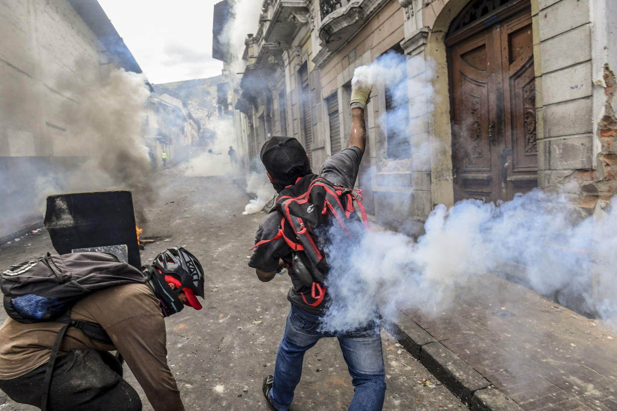 Demonstrators clash with riot police as thousands march against Ecuadorean President Lenin Moreno's decision to slash fuel subsidies, in Quito on Oct. 9, 2019. (Photo: Martin Bernetti/AFP via Getty Images)