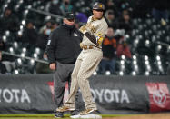 San Diego Padres' Manny Machado arrives at third with a three-run triple off Colorado Rockies relief pitcher Tyler Kinley during the sixth inning of a baseball game Tuesday, May 11, 2021, in Denver. (AP Photo/David Zalubowski)