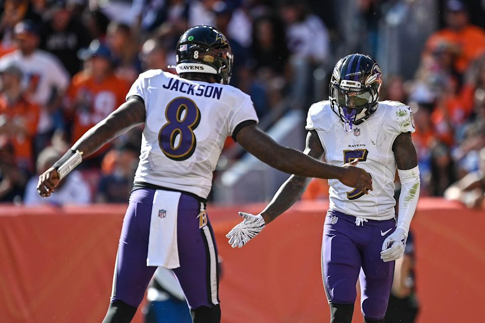DENVER, CO - OCTOBER 3:  Lamar Jackson #8 and Marquise Brown #5 of the Baltimore Ravens celebrate after connecting for a second quarter touchdown against the Denver Broncos at Empower Field at Mile High on October 3, 2021 in Denver, Colorado. (Photo by Dustin Bradford/Getty Images)
