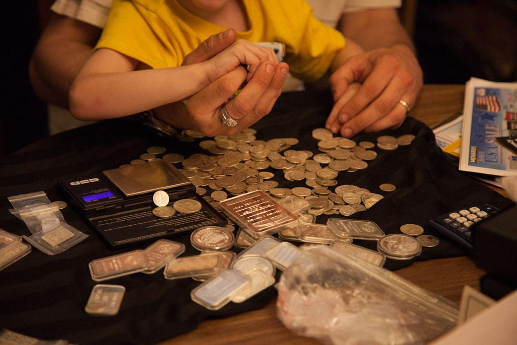 Mishawaka, IN - Bryan May teaches his son Orion about the importance of stockpiling gold and silver.