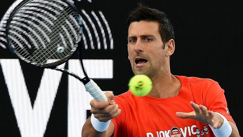 Novak Djokovic caused some confusion by briefly withdrawing from the exhibition series in Adelaide due to blistering on his hand. (Photo by MICHAEL ERREY/AFP via Getty Images)