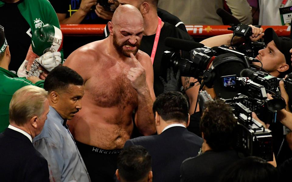 Fury was forced to scrap his way to a gory unanimous decision overpreviously undefeated Wallin - Getty Images North America