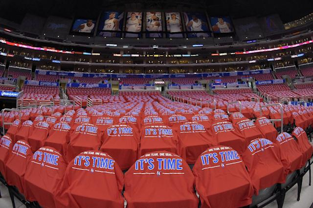 T-shirts cover empty seats before Game 7 of an opening-round NBA basketball playoff series between the Los Angeles Clippers and the Golden State Warriors, Saturday, May 3, 2014, in Los Angeles. (AP Photo/Mark J. Terrill)