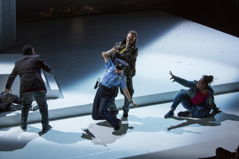 Actors Daniel Shirley and Kirstin Chavez wrestle over a weapon during a dress rehearsal for 'We Shall Not Be Moved,' a new opera on themes of racism and police brutality that opens Saturday in Philadelphia, Pennsylvania