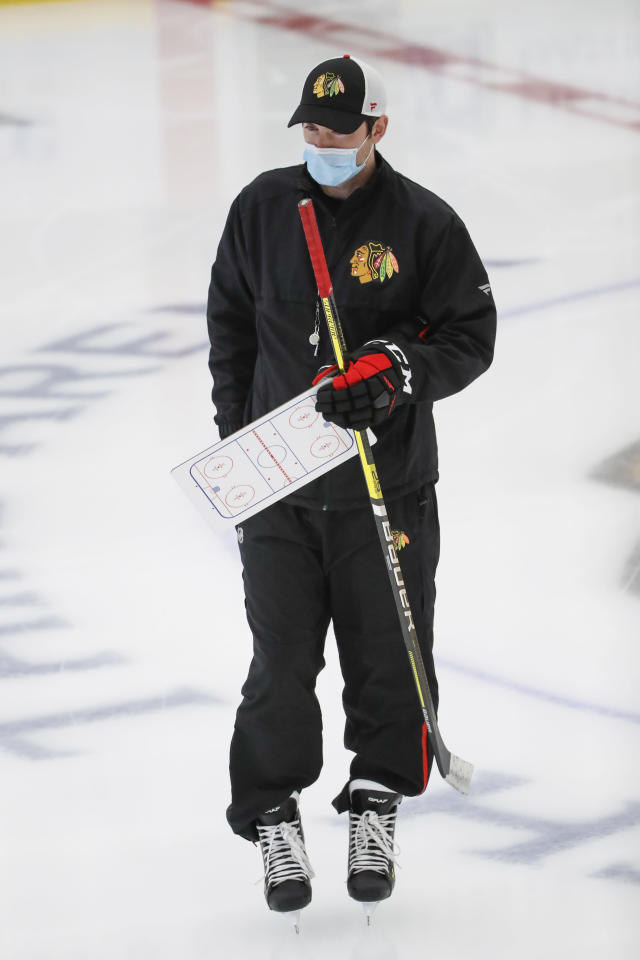 Chicago Blackhawks head coach Jeremy Collition takes the ice for NHL hockey practice at Fifth Third Arena on Monday, July 13, 2020, in Chicago. (AP Photo/Kamil Krzaczynski)