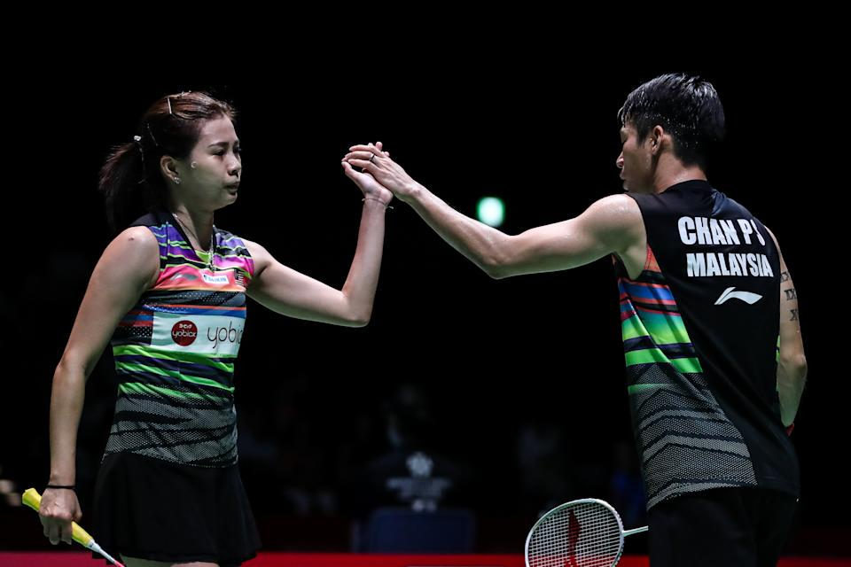CHOFU, JAPAN - JULY 26: Chan Peng Soon(R) and Goh Liu Ying of Malaysia react in the Mixed Doubles quarter finals match against Yuta Watanabe and Arisa Higashino of Japan during day four of the Daihatsu Yonex Japan Open Badminton Championships, Tokyo 2020 Olympic Games test event at Musashino Forest Sport Plaza on July 26, 2019 in Chofu, Tokyo, Japan. (Photo by Shi Tang/Getty Images)