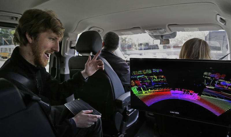 In this photograph taken on Monday, April 10, 2017, Luminar CEO Austin Russell gestures while looking at a 3D lidar map on a demonstration drive in San Francisco. Russell, now 22, was barely old enough to drive when he set out to create a safer navigation system for robot-controlled cars. His ambitions are about to be tested five years after he co-founded Luminar Technologies, a Silicon Valley startup trying to steer the rapidly expanding self-driving car industry in a new direction. (AP Photo/Ben Margot)