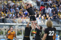 New Zealand's Scott Barrett is held aloft to win a lineout during the Rugby Championship game between the All Blacks and the Wallabies in Perth, Australia, Sunday, Sept. 5, 2021. (AP Photo/Gary Day)
