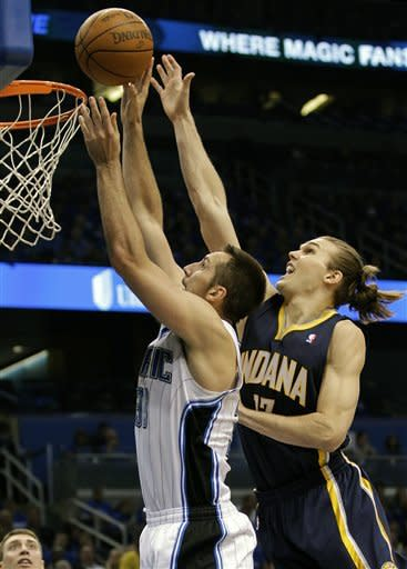 Indiana Pacers' Louis Amundson, right, blocks a shot by Orlando Magic's Ryan Anderson during the first half of Game 3 of an NBA first-round playoff basketball series, Wednesday, May 2, 2012, in Orlando, Fla. (AP Photo/John Raoux)