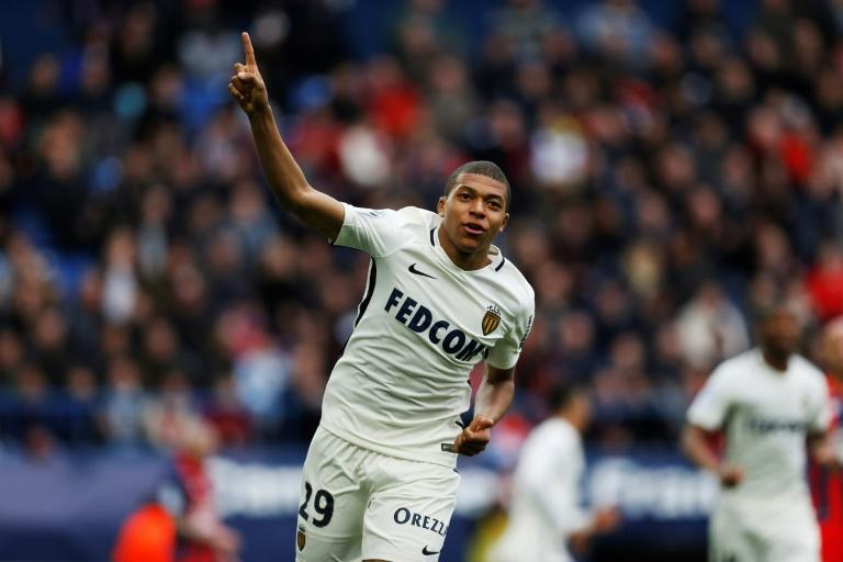 Monaco's forward Kylian Mbappe celebrates after scoring a goal against Caen on March 19, 2017 at the Michel d'Ornano stadium, in Caen, northwestern France