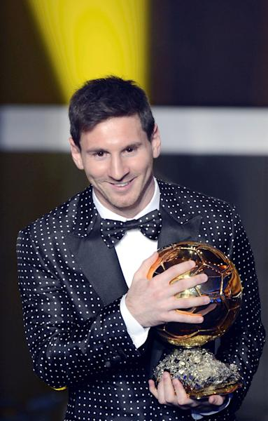 Argentina's Lionel Messi poses with the trophy after winning the FIFA Men's World Player of the Year Award during the FIFA Ballon d'Or Gala 2013 held at the Kongresshaus in Zurich, Switzerland, Monday, Jan. 7, 2013. (AP Photo/Keystone, Walter Bieri)