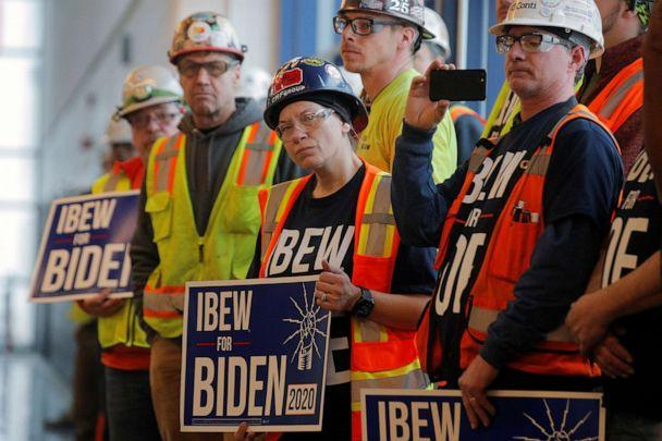 PHOTO: Workers are seen during a visit by Democratic presidential candidate and former Vice President Joe Biden at the FCA Mack Assembly plant in Detroit, March 10, 2020. (Brendan Mcdermid/Reuters)