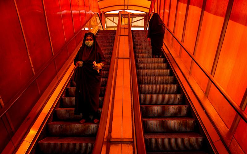 Women on public transport in coronavirus-stricken Iran  - Bloomberg/Ali Mohammadi