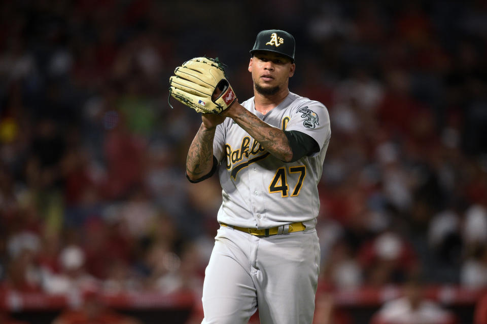 Oakland Athletics starting pitcher Frankie Montas claps while leaving the field after Los Angeles Angels' Phil Gosselin was forced out at first base to end the fifth inning of a baseball game in Anaheim, Calif., Thursday, July 29, 2021. (AP Photo/Kelvin Kuo)