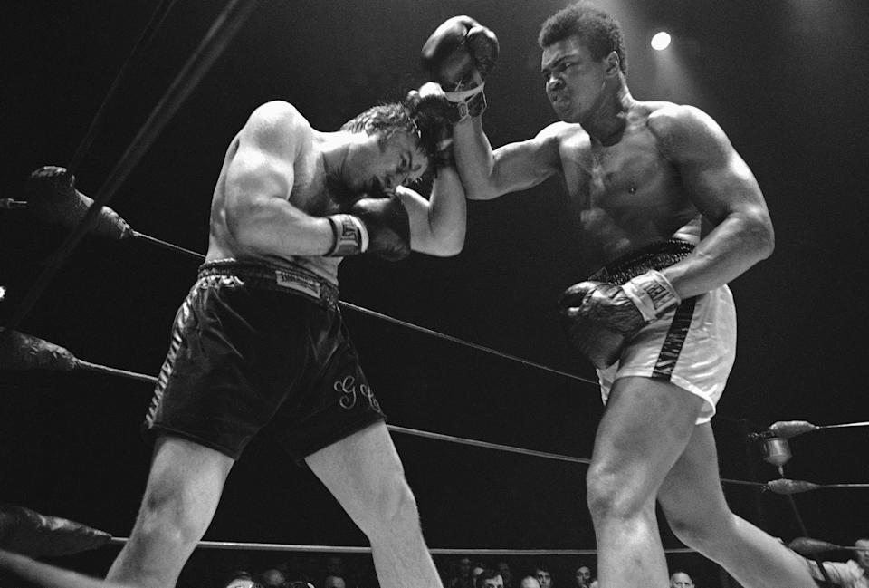 Former world heavyweight champion Muhammad Ali and Canadian champion George Chuvalo trade blows in their 12th round battle at Vancouver, British Columbia on May 2, 1972.   Note cut on Chuvalo?s forehead. Ali won the unanimous decision. (AP Photo)