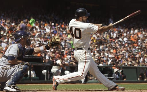 San Francisco Giants pitcher Madison Bumgarner (40) singles off of Milwaukee Brewers pitcher Randy Wolf to score Hector Sanchez during the fifth inning of a baseball game in San Francisco, Saturday, May 5, 2012. Also pictured at left is Brewers catcher George Kottaras. (AP Photo/Jeff Chiu)