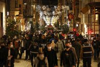 FILE - In this Thursday, Dec. 31, 2020 file photo, people walk along Istiklal street, the main shopping street in Istanbul, a few hours before a four-day lockdown, part of measures in a bid to stem the spread of the coronavirus. Turkish authorities on Wednesday, Jan. 13, 2021, gave the go-ahead for the emergency use of the COVID-19 vaccine produced by China's Sinovac Biotch Ltd. paving the way for the rollout for Turkey's vaccination program starting with health care workers and other high-risk groups in the country of 83 million.Turkey has reported some 2.34 million infections and around 23,000 deaths. (AP Photo/Emrah Gurel, File)