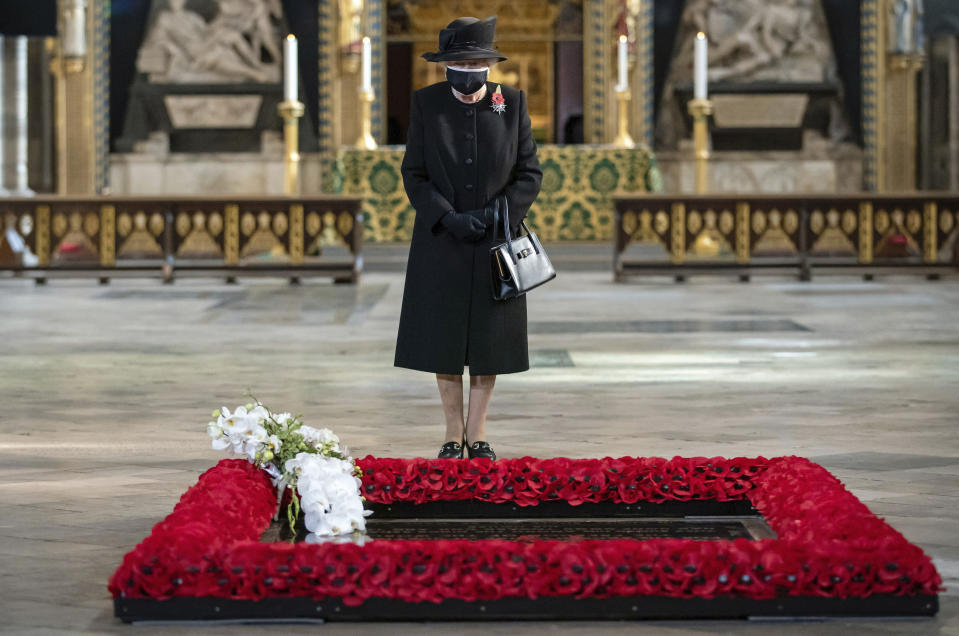 Britain's Queen Elizabeth II attends a ceremony to mark the centenary of the burial of the Unknown Warrior, in Westminster Abbey, London, Wednesday, Nov. 4, 2020. Queen Elizabeth II donned a face mask in public for the first time during the coronavirus pandemic when attending a brief ceremony at Westminster Abbey last week to mark the centenary of the burial of the Unknown Warrior. While the 94-year-old has been seen in public on several occasions over the past few months, she has not worn a face covering. (Aaron Chown/Pool Photo via AP)