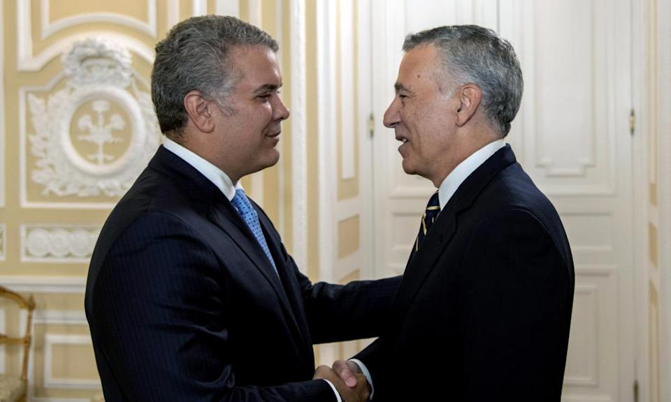 The Colombian president, Ivan Duque, left, with Philip Goldberg, the US ambassador to Bogotá.