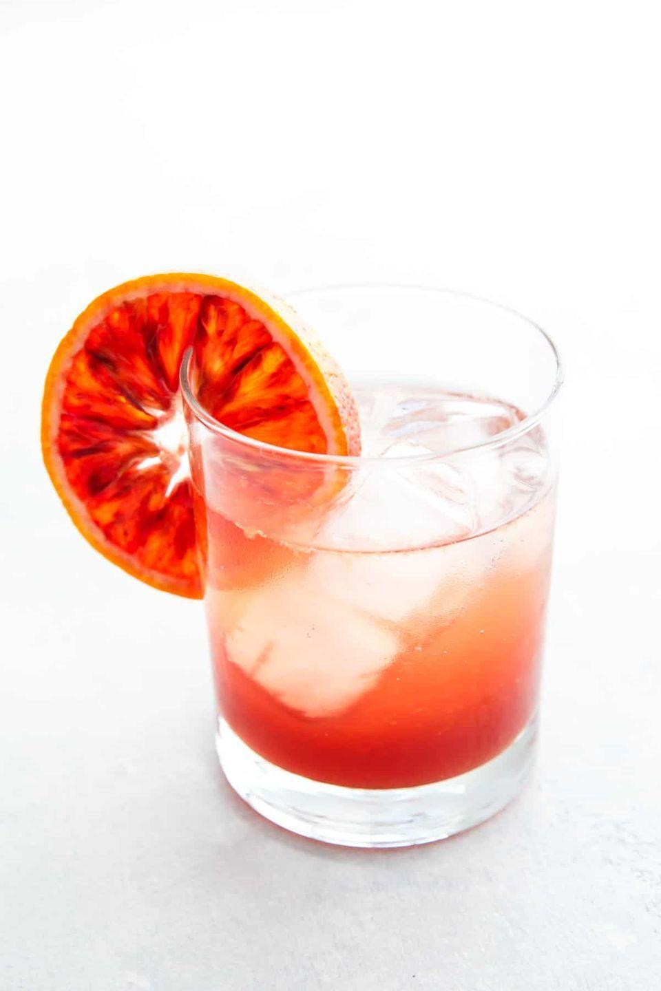 """<p>For a cocktail that's as vibrant as the sunset, try this mix of gin, fresh blood orange juice, vanilla bean, and Meyer lemon sugar syrup. </p><p>Get the recipe at <a href=""""https://www.loveandoliveoil.com/2016/12/sicilian-gin-spritz-cocktail.html"""" rel=""""nofollow noopener"""" target=""""_blank"""" data-ylk=""""slk:Love & Olive Oil"""" class=""""link rapid-noclick-resp"""">Love & Olive Oil</a>. </p>"""