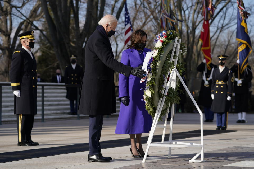 President Joe Biden and Vice President Kamala Harris participate in a wreath laying ceremony at the Tomb of the Unknown Soldier at Arlington National Cemetery in Arlington, Va.on Jan. 20, 202. (Evan Vucci/AP)