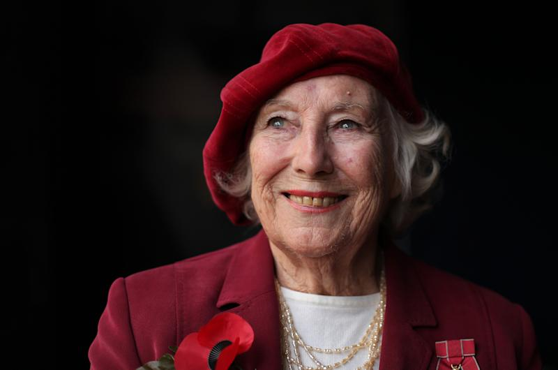 Forces sweetheart Dame Vera Lynn poses for photographs in central London, on October 22, 2009. Forces sweetheart Dame Vera Lynn on Thursday joined soprano singer Hayley Westenra for an emotional rendition of the classic wartime song We'll Meet Again to officially launch the Royal British Legion's poppy appeal. AFP PHOTO/Shaun Curry (Photo by SHAUN CURRY / AFP) (Photo credit should read SHAUN CURRY/AFP via Getty Images)