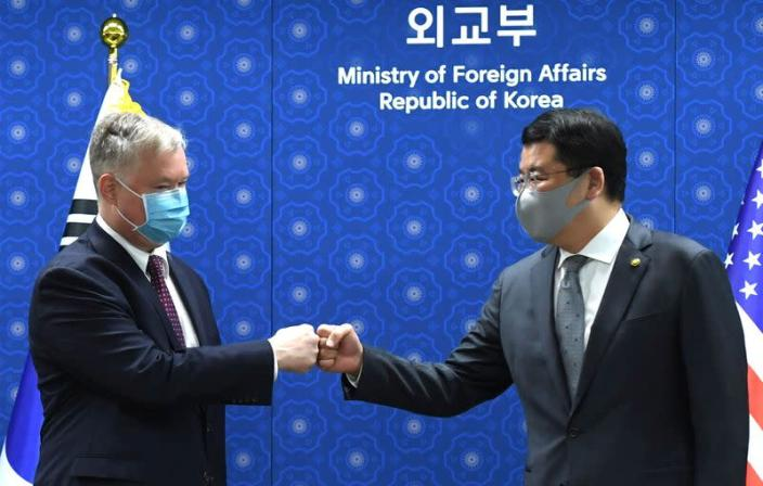 U.S. Deputy Secretary of State Stephen Biegun bumps fists with South Korean Vice Foreign Minister Choi Jong-kun during their meeting at the Foreign Ministry in Seoul