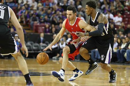 Nov 29, 2013; Sacramento, CA, USA; Los Angeles Clippers shooting guard J.J. Redick (4) controls the ball against Sacramento Kings shooting guard Ben McLemore (16) during the first quarter at Sleep Train Arena. Mandatory Credit: Kelley L Cox-USA TODAY Sports