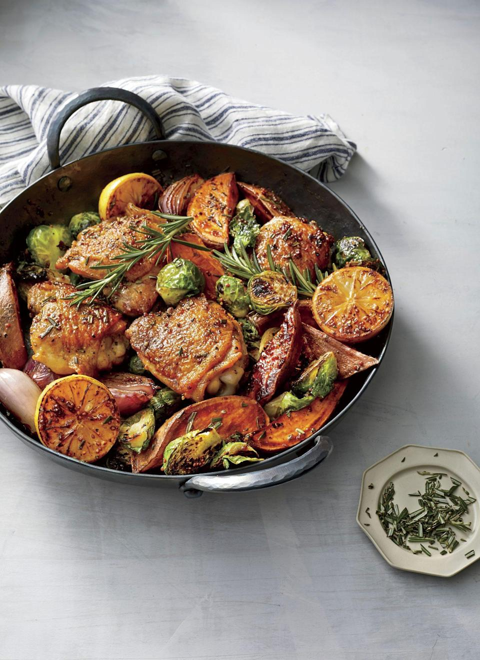"""<p><strong>Recipe: <a href=""""https://www.southernliving.com/recipes/oven-baked-chicken-thighs-vegetables"""" rel=""""nofollow noopener"""" target=""""_blank"""" data-ylk=""""slk:Oven Baked Chicken Thighs with Vegetables"""" class=""""link rapid-noclick-resp"""">Oven Baked Chicken Thighs with Vegetables</a></strong></p> <p>Bright lemon, fresh rosemary, and a homemade honey mustard mixture add so much flavor to a simple chicken-and-veggies supper. Our Test Kitchen recommends smaller chicken thighs, which tend to be juicier.</p>"""